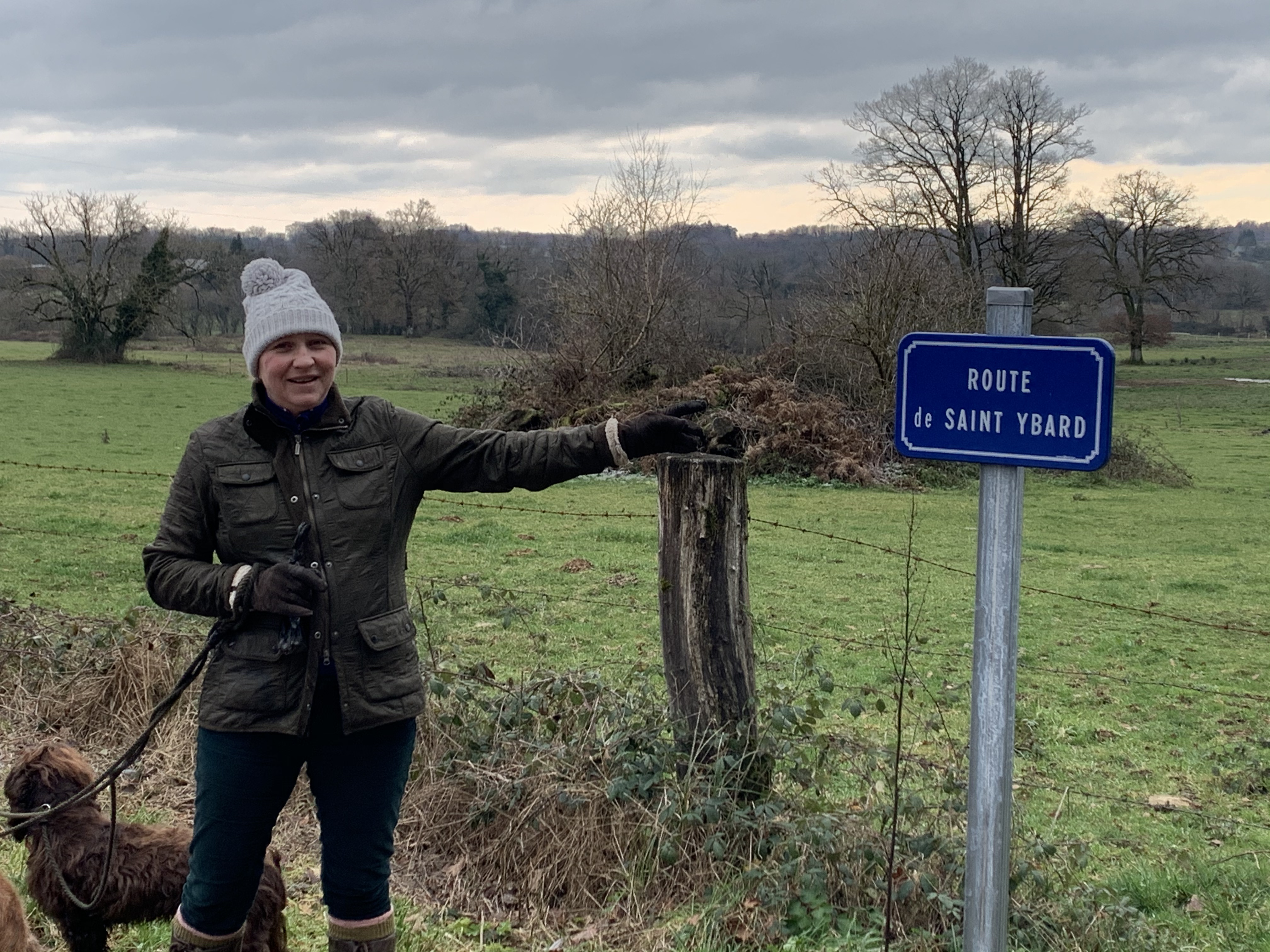 woman pointing at a sign